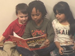Three students share a book.