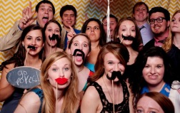 """Photo booth fun at a """"Jim and Pam love story"""" wedding."""