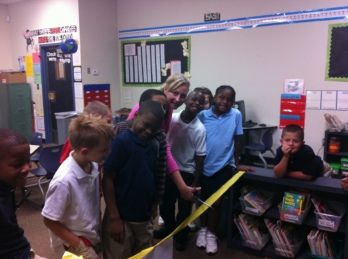 Cutting the ribbon to our classroom library, 2012